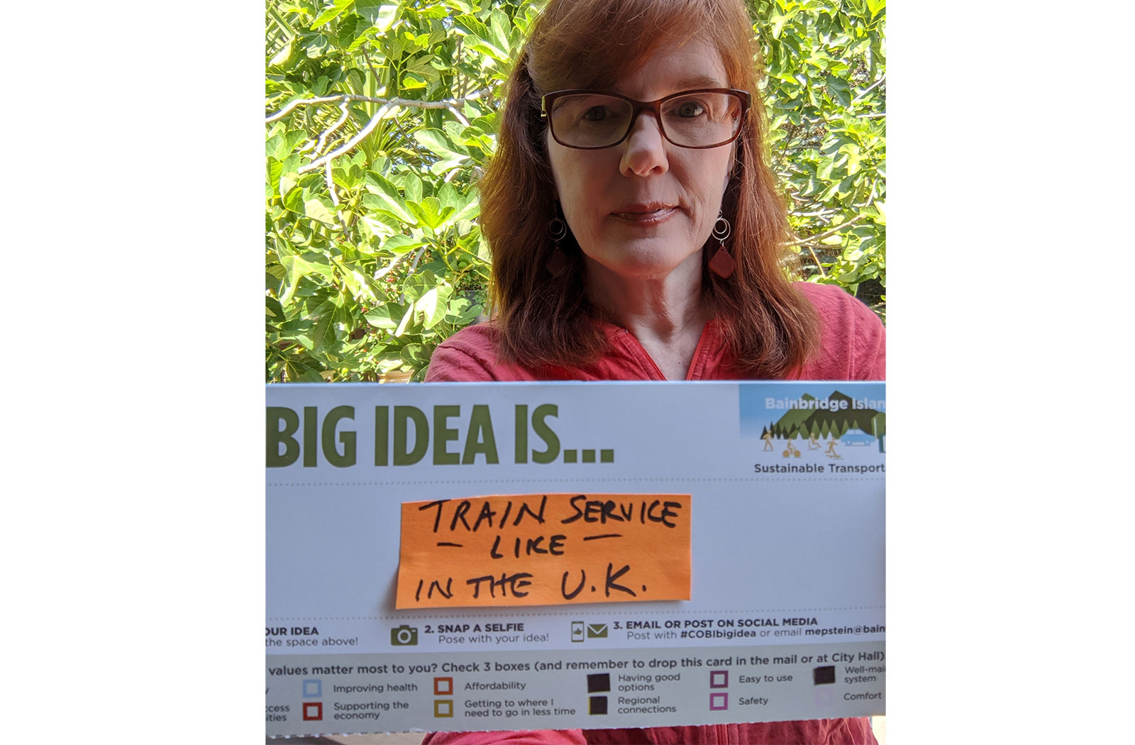a postcard stating a community member's big idea to have train service like in the UK