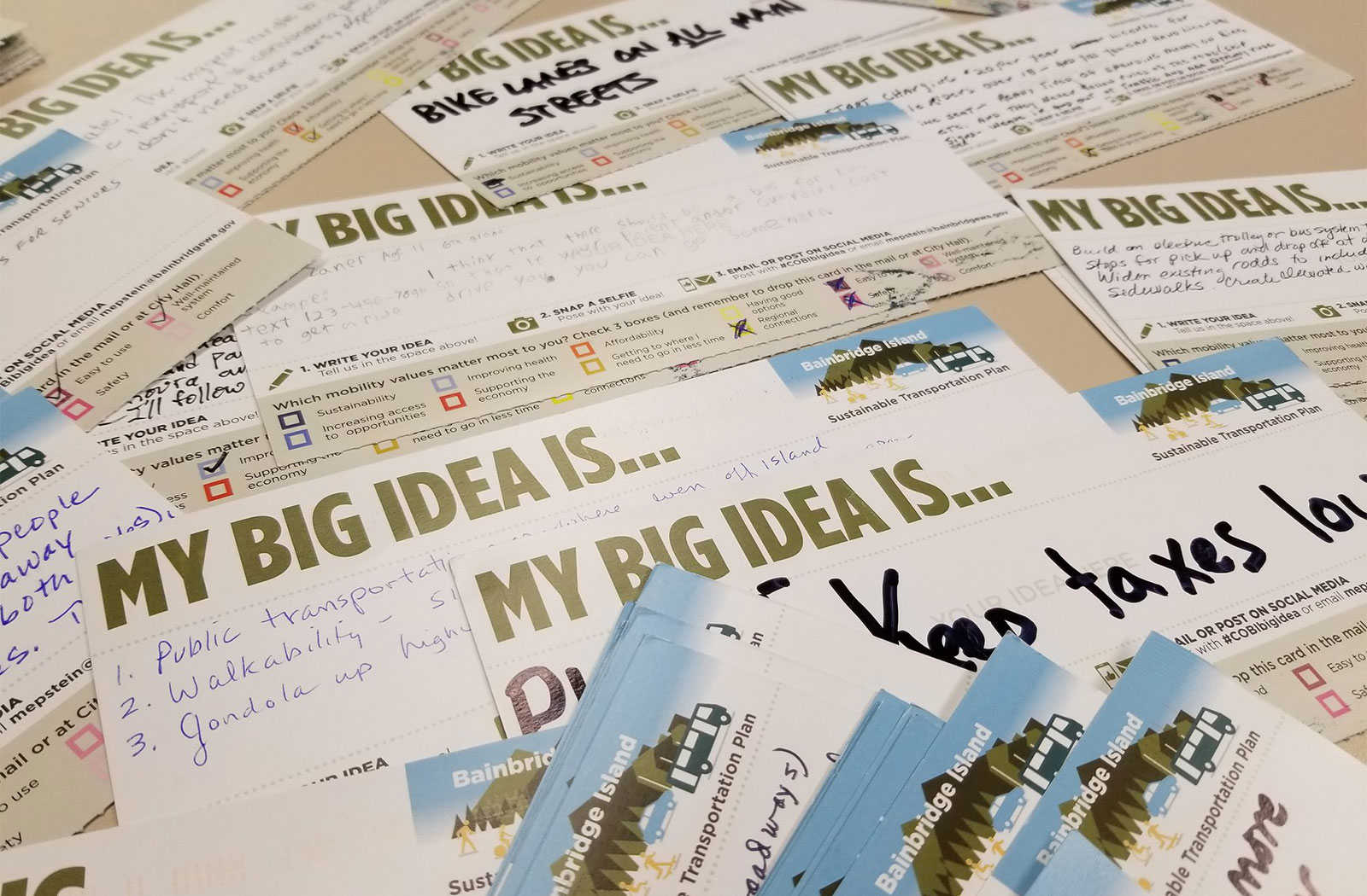 a pile of postcards with various Big Ideas written out by community members