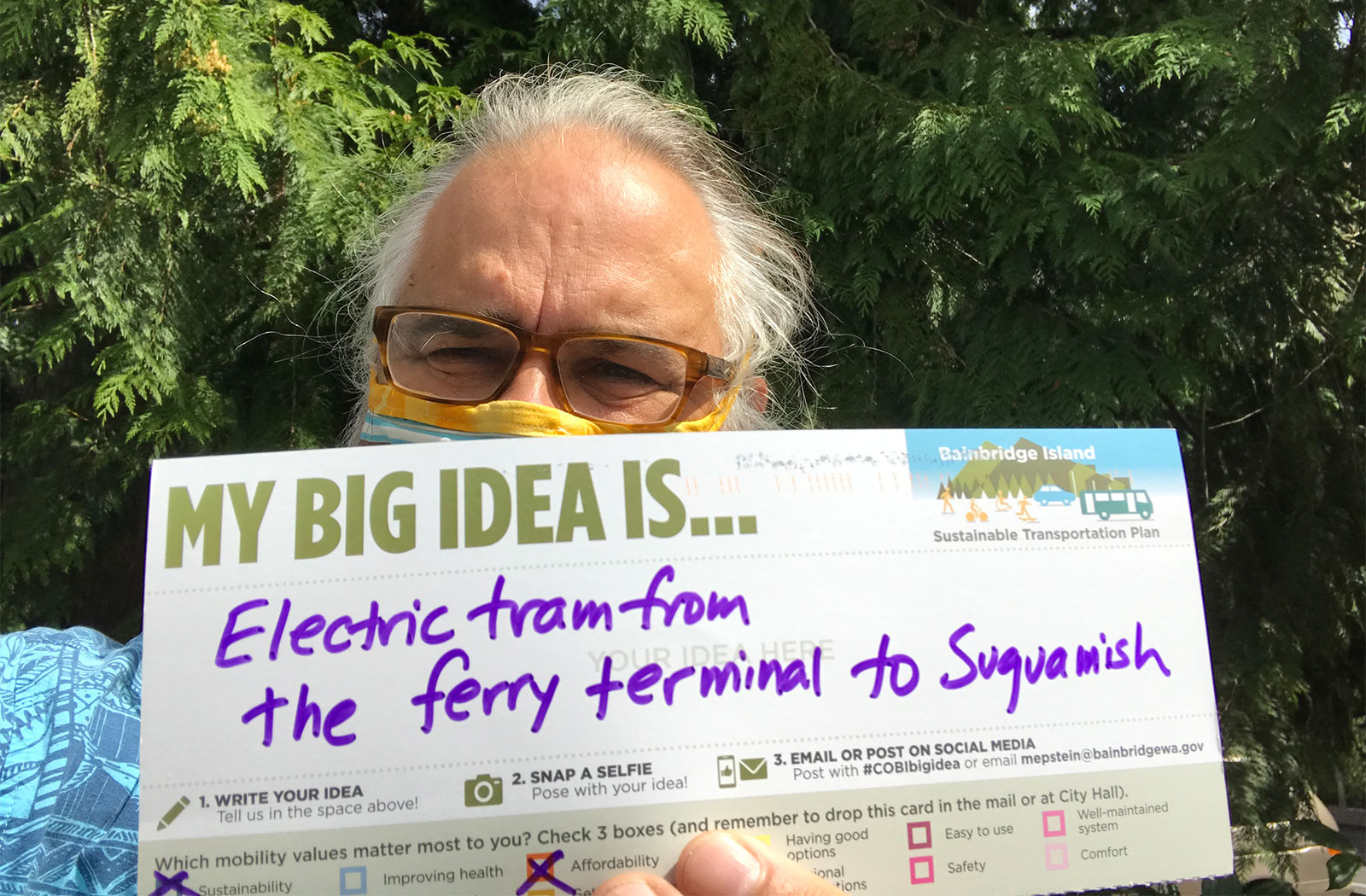 a postcard stating a community member's big idea to have an electric tram from the ferry terminal to Suquamish